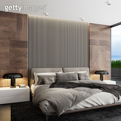 Wooden panels wall in luxurious apartment master bedroom interior