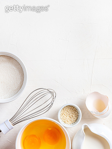 Frame of food ingredients for baking on a white background