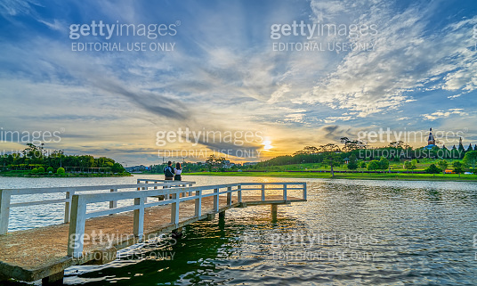 Dawn on the lake with lovers relaxing