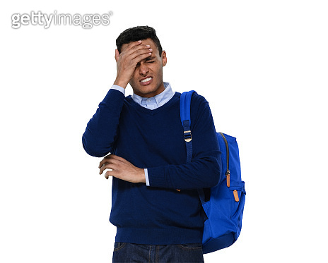 Generation z young male standing in front of white background wearing jeans