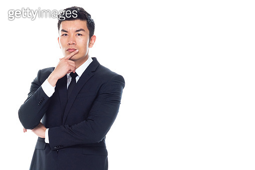 Chinese ethnicity male business person standing in front of white background