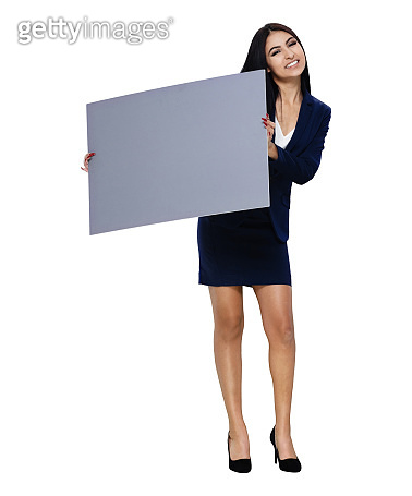 Latin american and hispanic ethnicity young women business person standing wearing blazer and holding sign