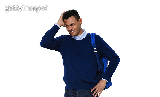 African ethnicity young male standing in front of white background wearing sweater