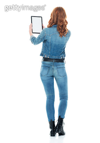 Caucasian female standing wearing boot and using touch screen