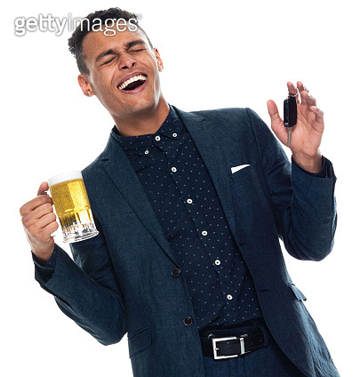 African-american ethnicity young male businessman relaxing in front of white background wearing business casual and holding beer - alcohol