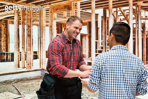 Young male expertise repairing wearing lumberjack shirt