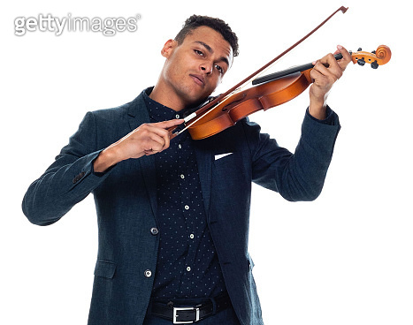 African-american ethnicity young male musician standing in front of white background wearing business casual and holding musical instrument