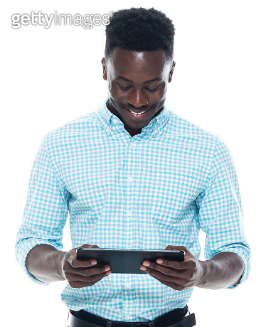 African-american ethnicity male standing wearing button down shirt and using digital tablet