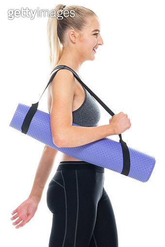 Generation z teenage girls ready for yoga in front of white background wearing jogging pants and using exercise mat
