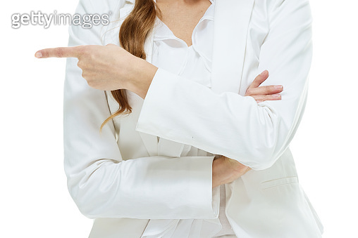 Caucasian young women business person in front of white background wearing businesswear