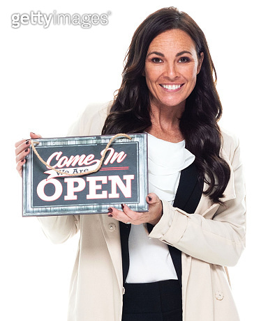 Caucasian young women owner standing in front of white background wearing businesswear and holding open sign