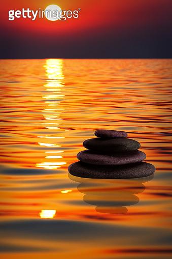Zen concept. Object from stones on a sunset background. Harmony & Meditation. Zen stones.