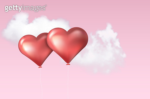 Two inflatable balloons in shape of heart and sky