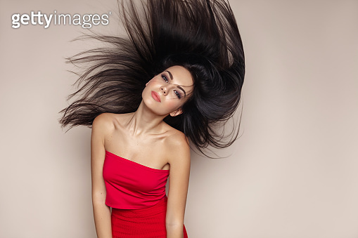 Fashion portraif of young model with long healthy hair flying. Hair care concept.