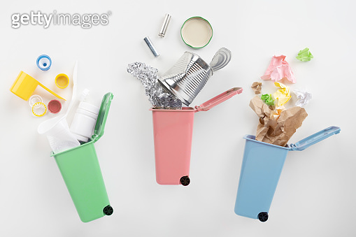 Separate garbage collection. Colored trash cans. Metal, paper and plastic.