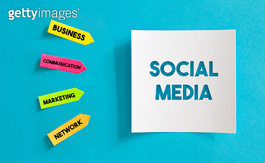 Colorful Sticky Notes Papers And White Paper with Social Media Message Over the Blue Paper.