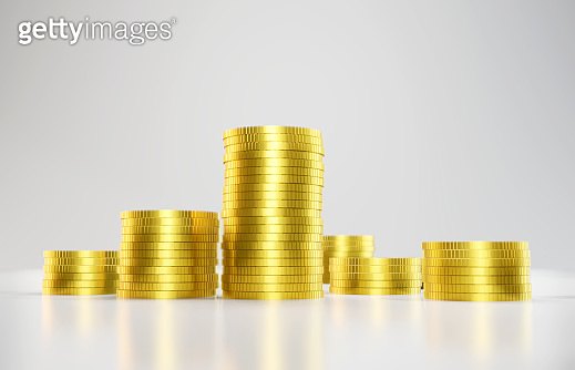 Gold Coins On White Background. Earnings, investment and economy concept.