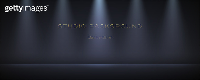 Black empty studio with many spotlights. Soft gradient on the wall and floor. Dark room can used for background and display brand or product. Black edition.