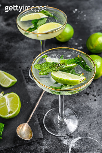 Mojito cocktail, Refreshing mint with rum and lime, cold drink or beverage. Black background. Top view