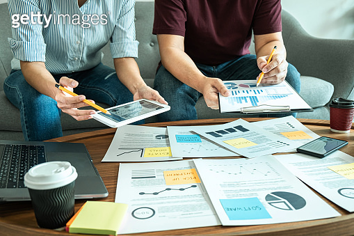 Business casual team are presenting and discussing company growth project success financial statistics, professional investor working start up project for strategy plan with document