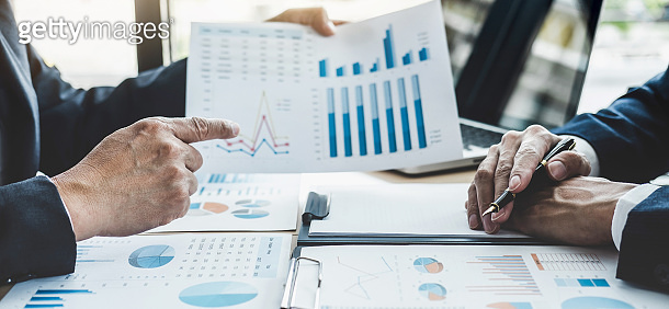 Finance manager meeting discussing company growth project success financial statistics, professional investor working start up project for strategy plan with document, laptop and digital tablet