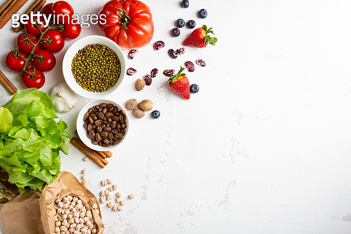White food background with beans and berry