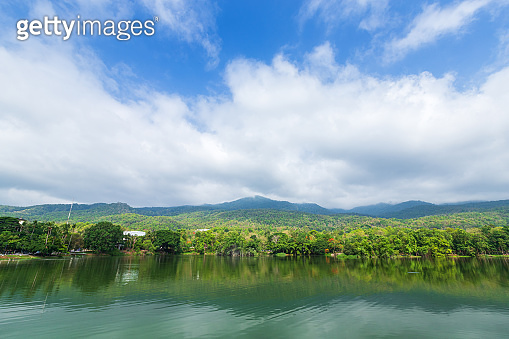 Mountain range forest with the reservoir blue sky background in Ang Kaew Chiang Mai University,Thailand.