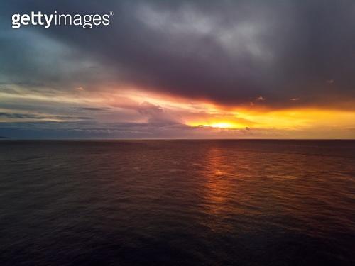 Bright colourful sunset with gloomy cloudy sky over Mediterranea Sea