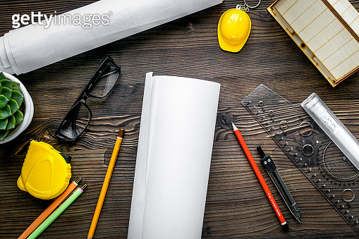 Construction office with architect tools on wooden background top view