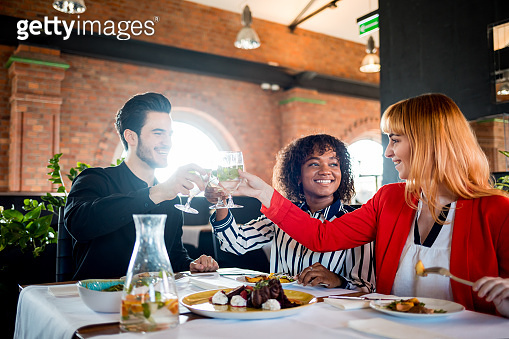Business people toasting and celebrating in restaurant