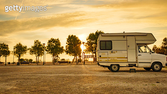 Camper car on beach at evening