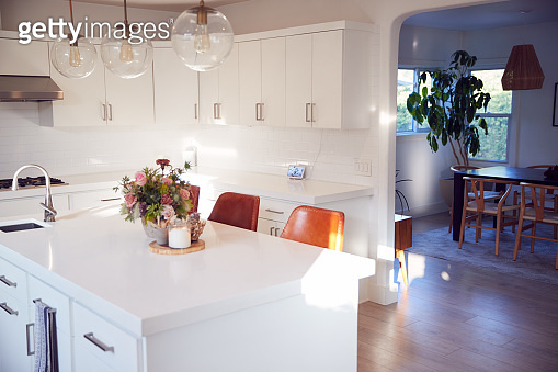 Interior View Of Beautiful Kitchen With Island Counter Looking To Dining Room In New Family House