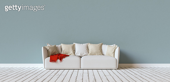 Sofa on a blue wall in living room with space for canvas, banner size, copyspace for your individual text.