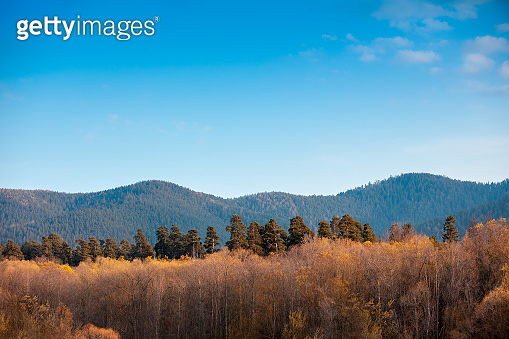 Autumn in the mountains. View of the mountains in autumn. Beautiful nature landscape. High Tatry, Slovak Republic, Europe