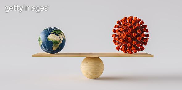 wooden scale balancing big Earth ball and Coronavirus or Covid-19. Concept of harmony and balance