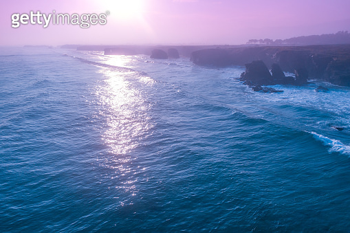 Rocky sea coast at sunrise. Beach Beach of Las Catedrales in Ribadeo, Spain, Europe. Aerial view