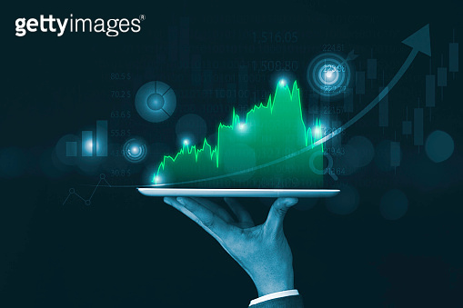 Economic and profit of stock market investment growth concept , Businessman holding smartphone with green chart with arrow.