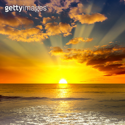 Majestic bright sunrise over ocean