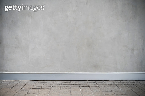 Gray concrete wall with grunge and floor. Empty room for backdrop or background.