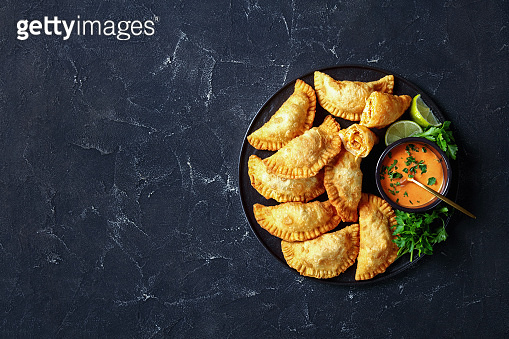 delicious deep-fried empanadas with shredded chicken filling