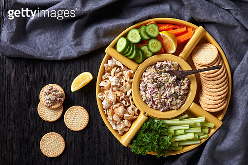 No-Cook Tuna capers pickles Spread set served with carrots and celery sticks, sliced fresh cucumber, crackers and pork rinds in bowls