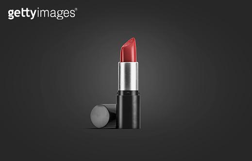 Blank black lipstick tube mockup, isolated on dark