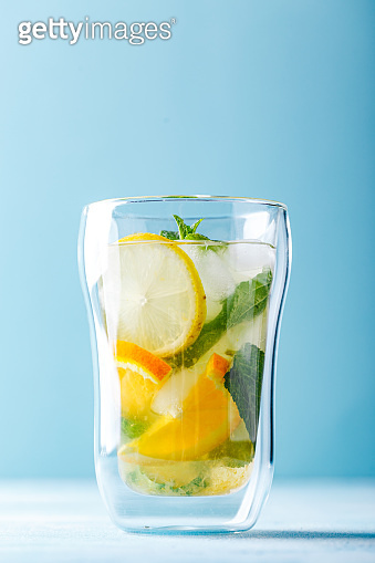 Refreshing cocktails with mint with lemon, orange, mint and ice