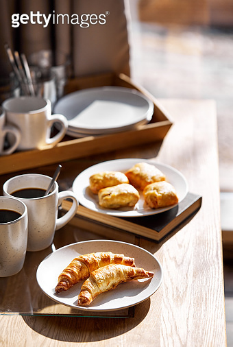French croissants with black coffee