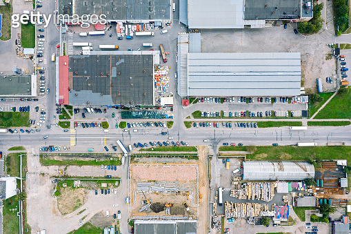 aerial top view of industrial zone with factories, plants and warehouses