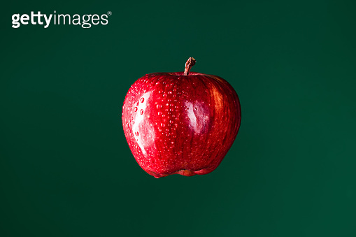 Red apple hanging in the air