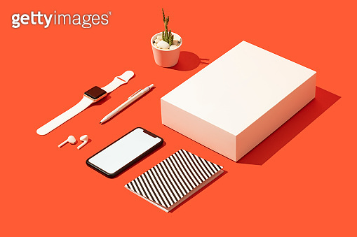 Smart phone mockup, template on red background with white gift box and personal accessories