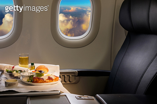 Tasty meal served on board of airplane on the table