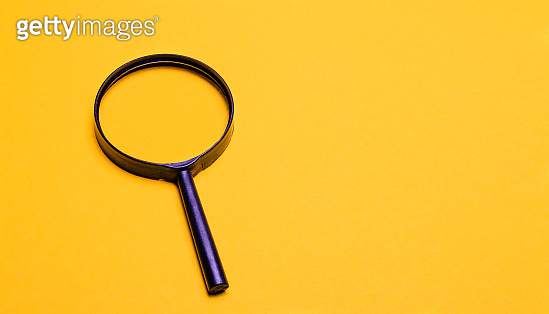 Magnifier on a yellow background. Space to copy and paste text or illustrations