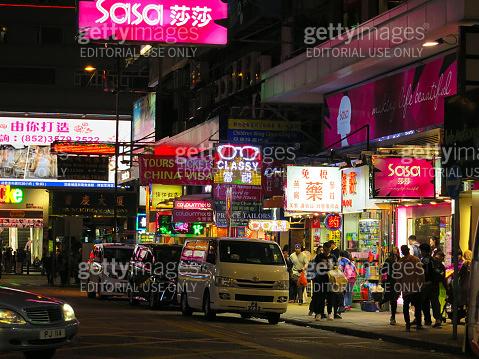 Hong Kong crosswalk in business financial district downtown neon lights